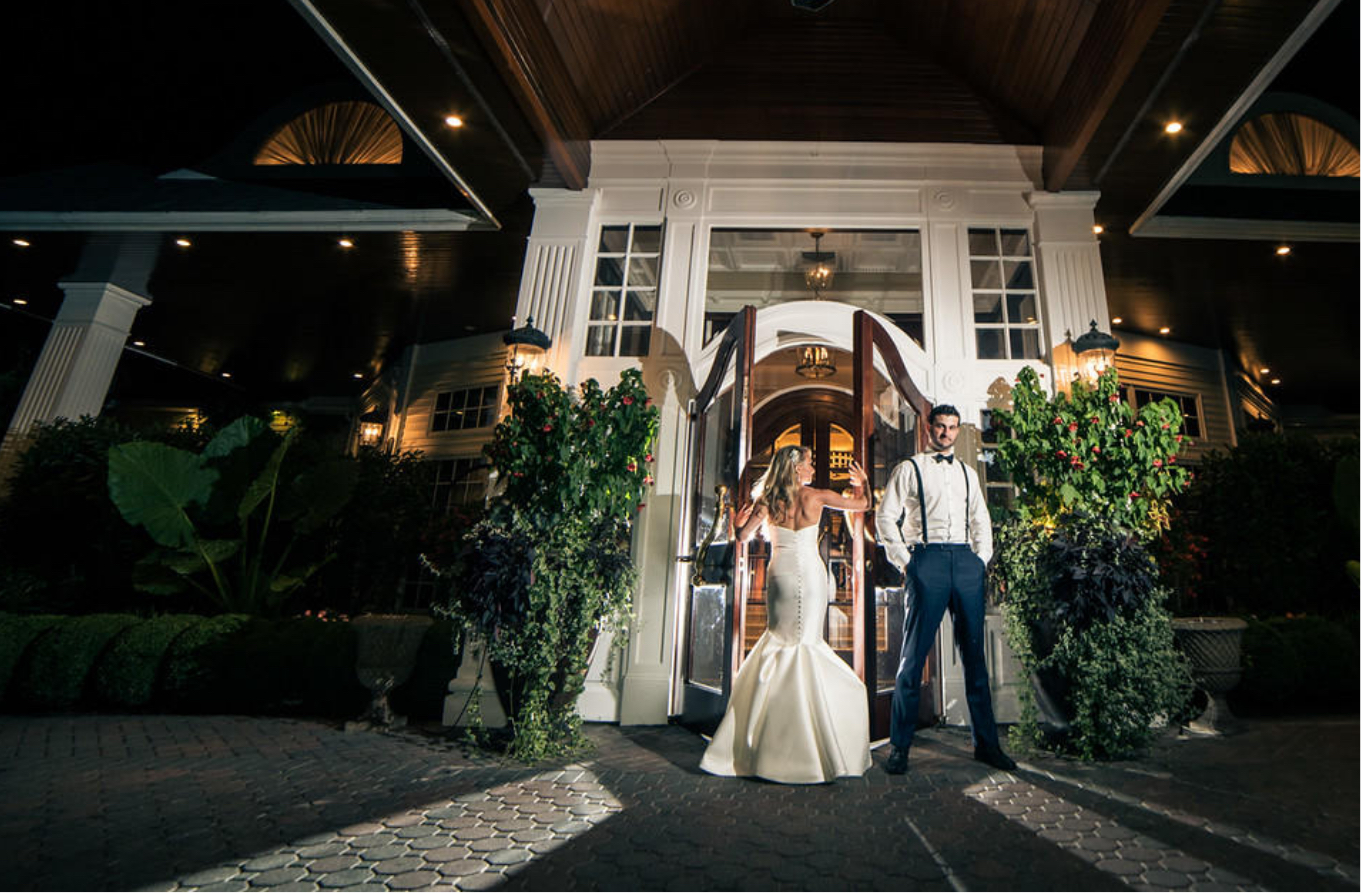 couple in front of watermill doors