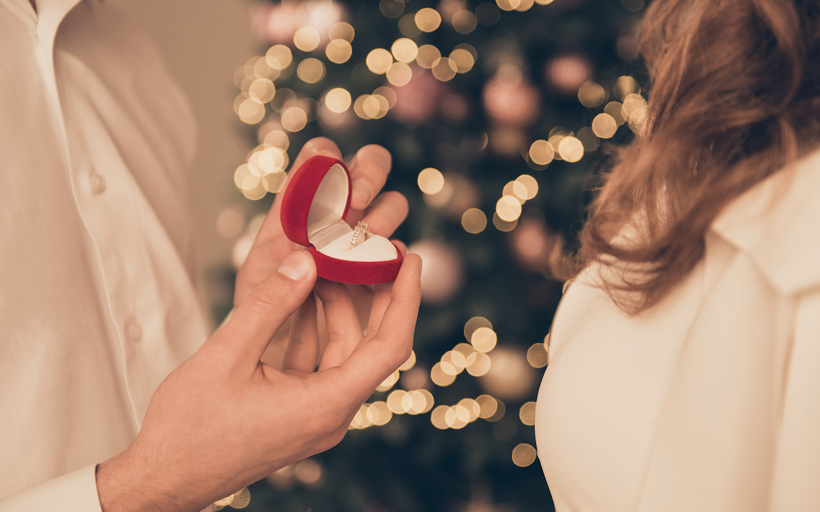 man proposing to woman with engagement ring