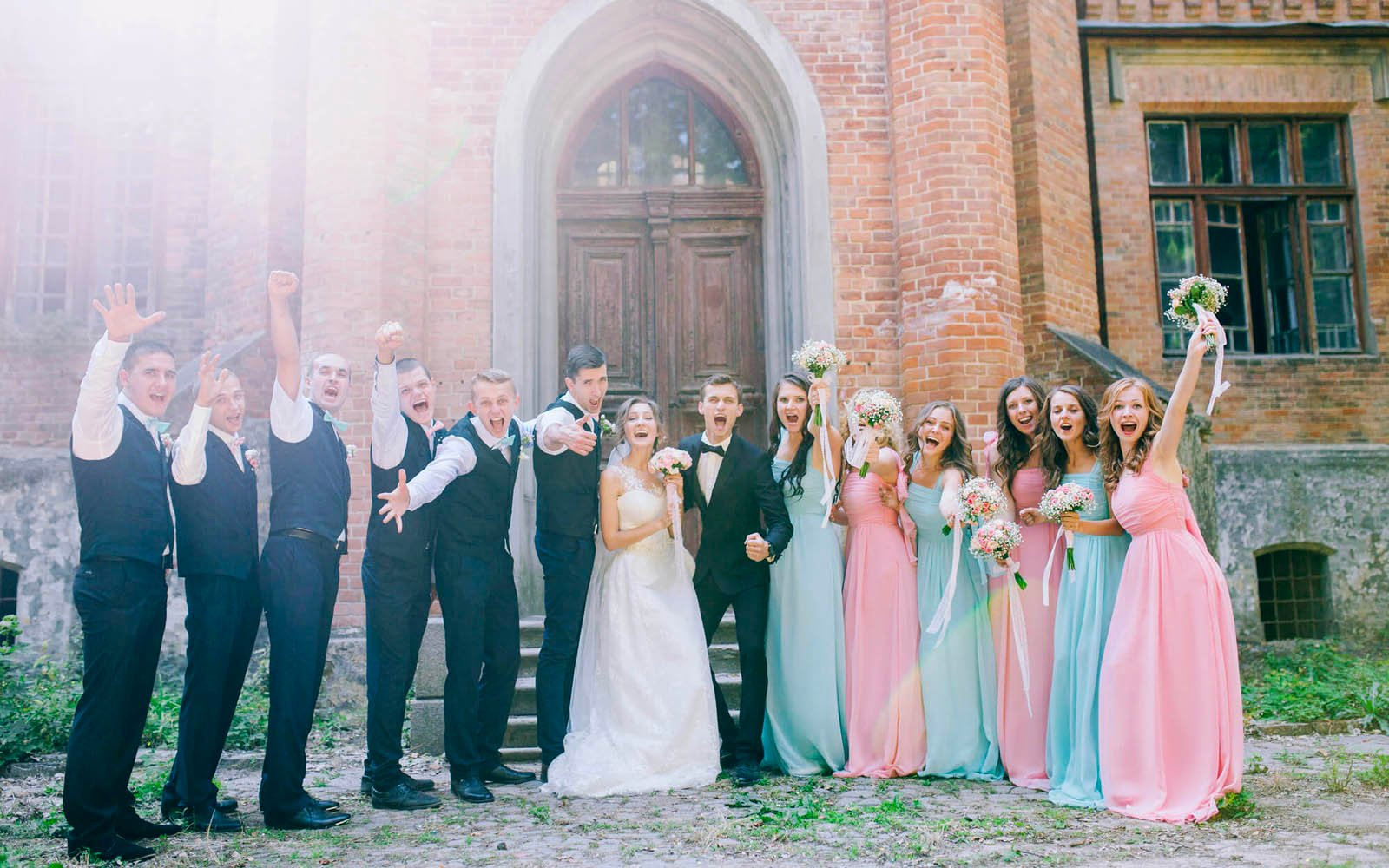 Bridesmaids and Groomsmen posing for fun photo at wedding with bride and groom